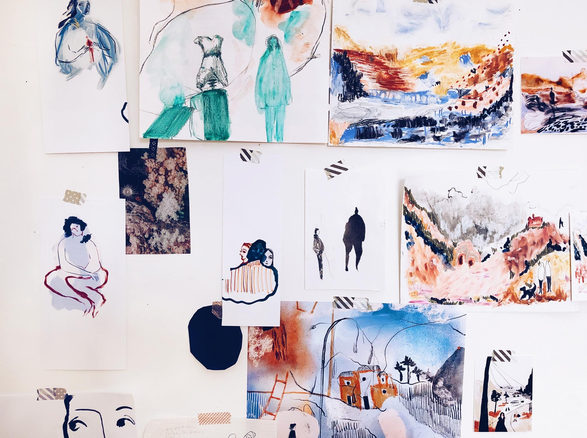 A wall with colourful drawings and figures
