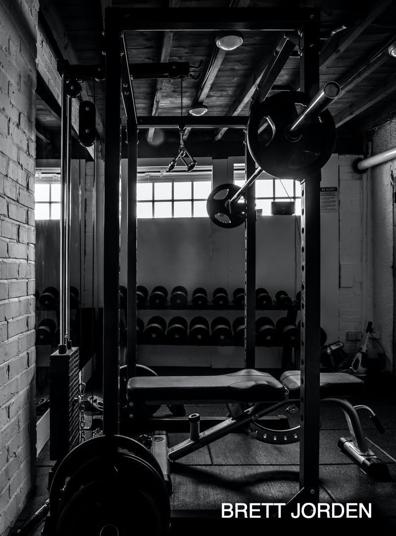 exercise equipments in grayscale photography
