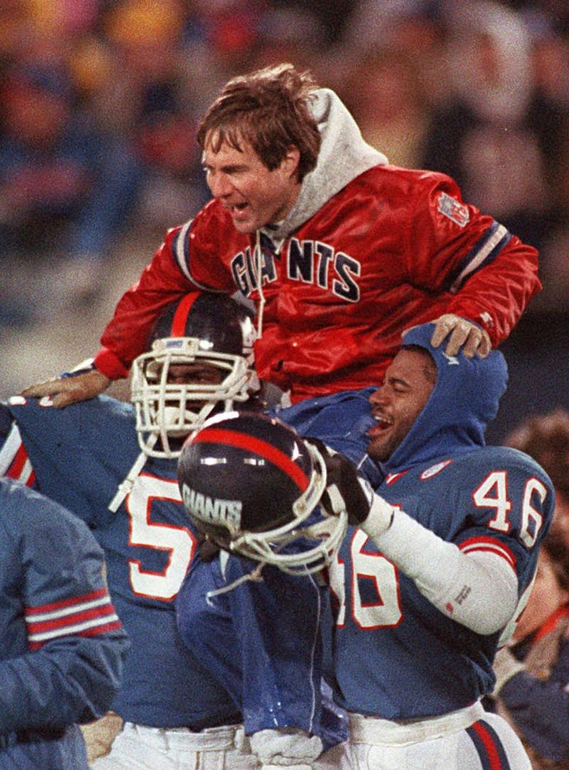 Bill Belichick lifted onto the shoulders of NY Giants' players in celebration of their victory over the Buffalo Bills