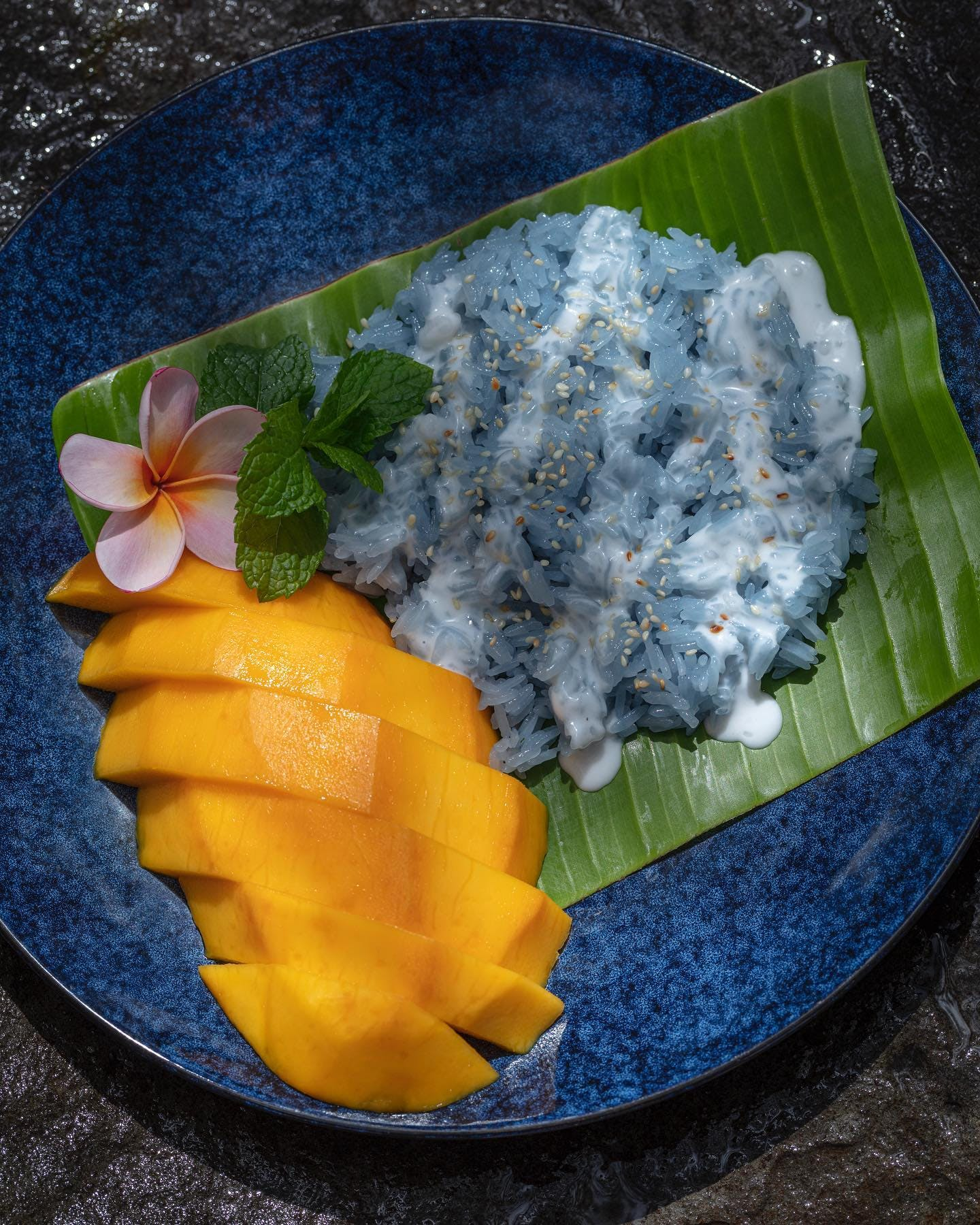 Thai Sticky Rice with Mango by @imimstreetfood  One of my most favourite dishes in the world and now have the recipe published in Noosa's very own cookbook @cooknoosa  I remember the first time I tried this dish. My family and I had traveled to Bangkok to see my brother marry a beautiful Thai girl, Wongduan aka Moon. Moon's Mum had heard of my love for Thai food and stayed up all night making little packages of sticky rice wrapped in banana leaves for me - the night before her daughter's wedding. I was overwhelmed by her generosity and kindness.  Moon and my brother have been married 10 years now and I still crave those little parcels of sticky rice. The only thing that satisfies my craving is Im Im Street Food's Khao Niaow Ma Muang (Sticky Rice with Mango) Thanks for sharing your recipe with us Usa @imimstreetfood and thanks to Moon's mama for creating an amazing food memory for me and my family. #noosa #noosaindustrialestate #thaifood #imimstreetfood #foodvan #cooknoosa #noosacookbook   📸 @emma_jane_sheldrake for @cooknoosa