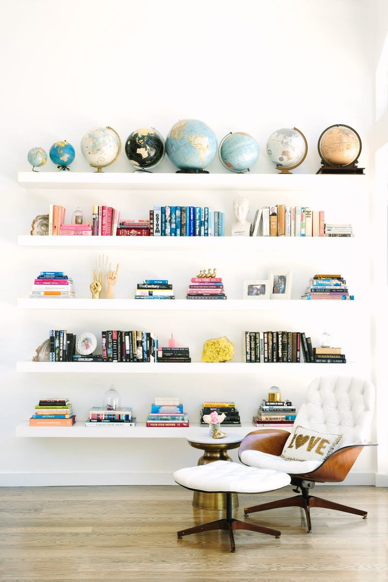 Spruce Up Your Home While Sheltering in Place | Floating bookcase | Globe collection