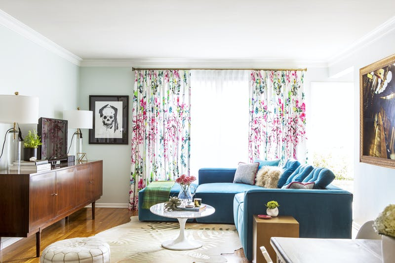 Bright and colorful living room with a teal sofa by Los Angeles and Fort Worth based interior designer Jessica McClendon