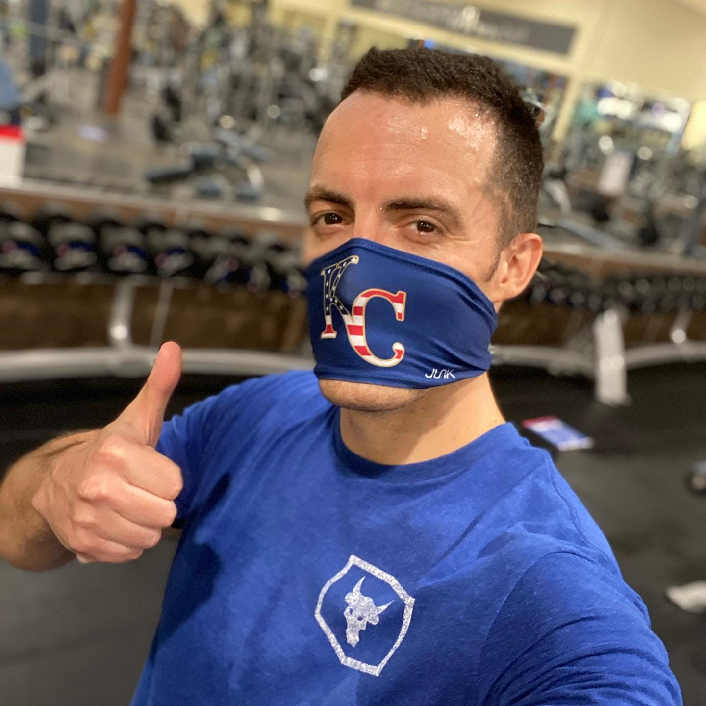blue shirt thumbs up kc mask
