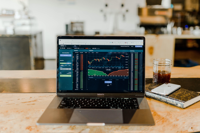 Laptop displaying investment graphs