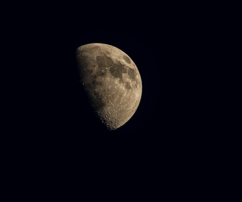 brown full moon in dark night sky