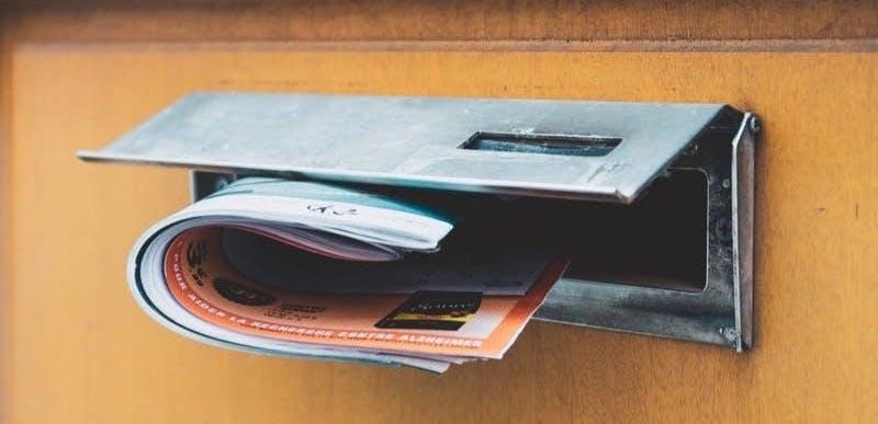 brochure on door's mail slot