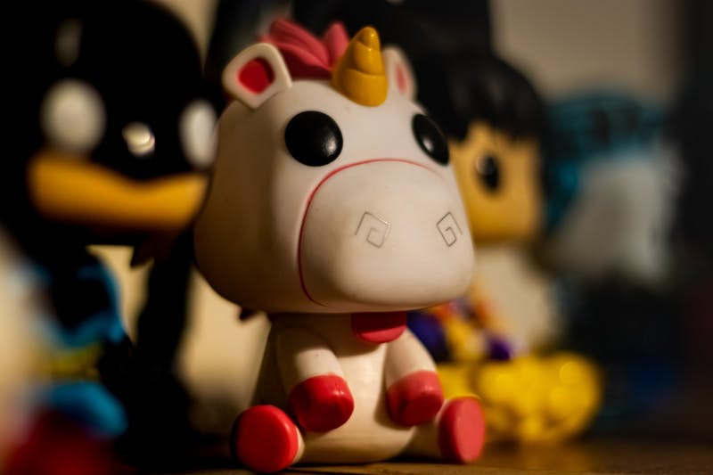 white and black cow plastic toy