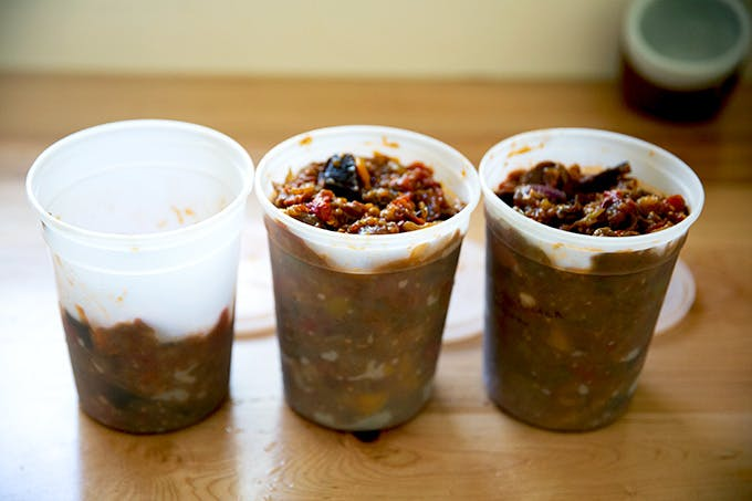 Quart containers filled with roasted ratatouille.