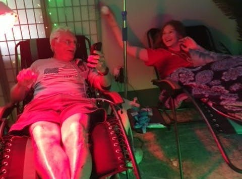 A man and a young girl getting Crohn's disease infusion IV therapy.