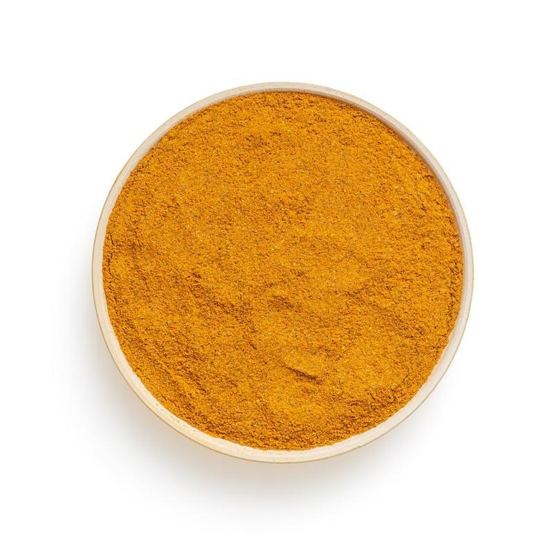 round brown powder on white surface