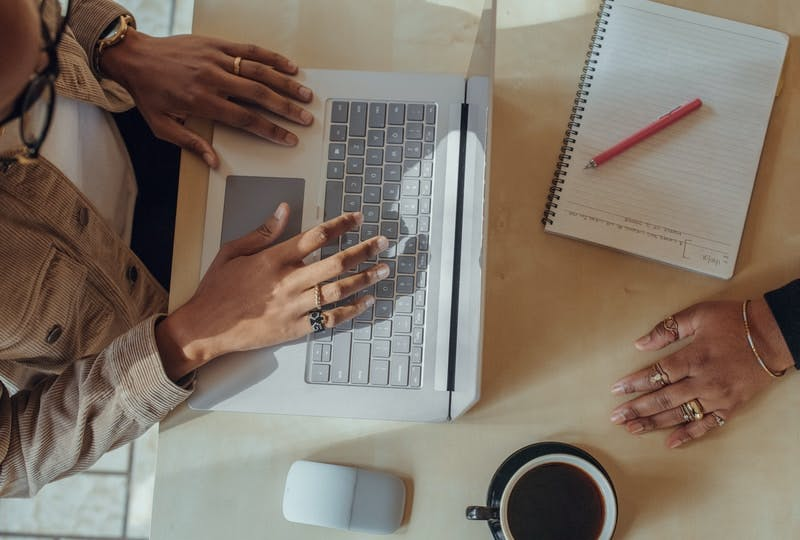 person typing on Surface laptop