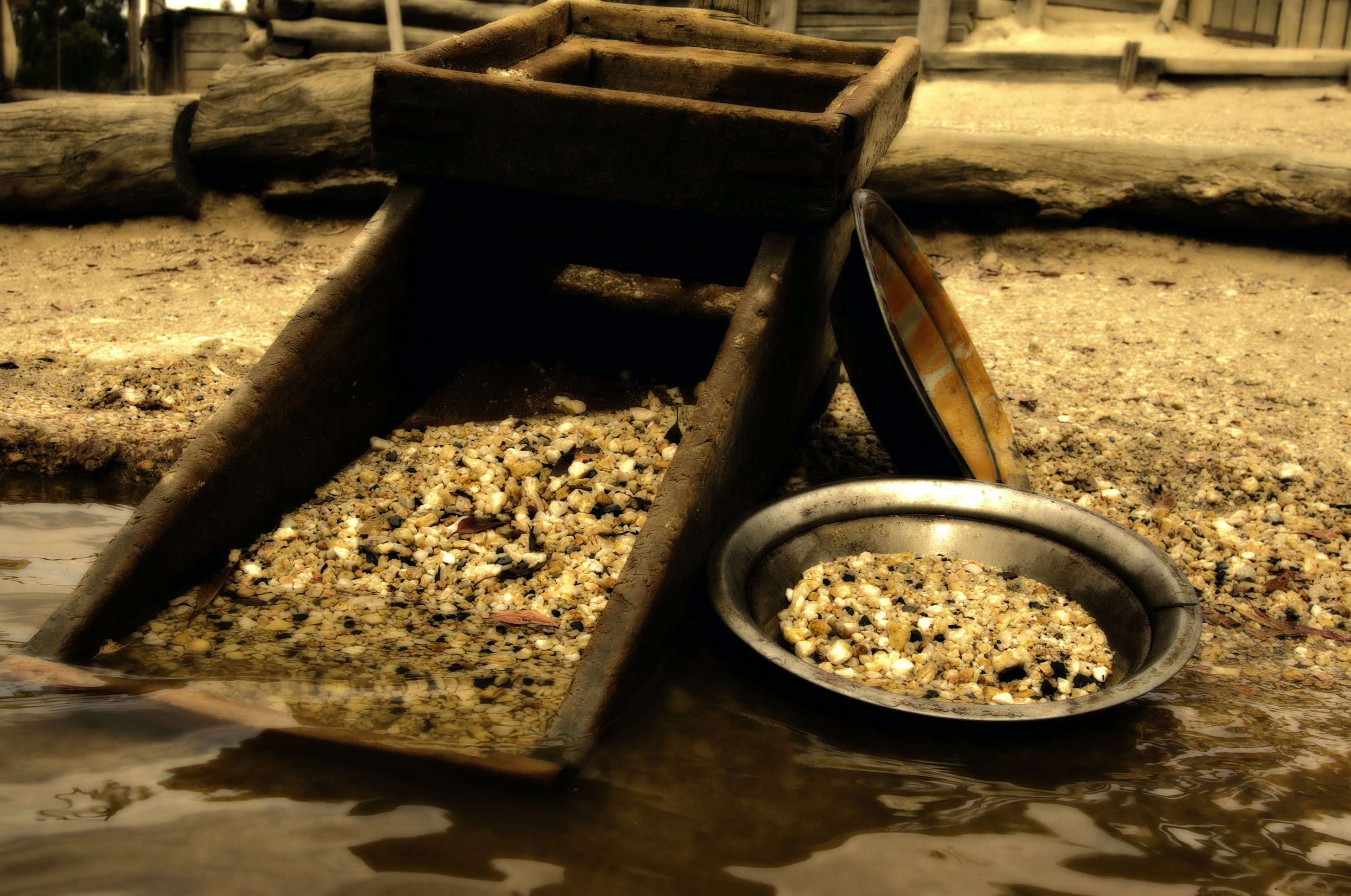 pan with gold in river