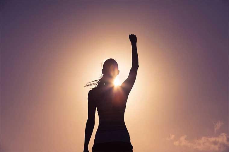 woman raising hand